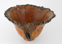 Natural edge cherry bowl turned by Dennis Curtis.